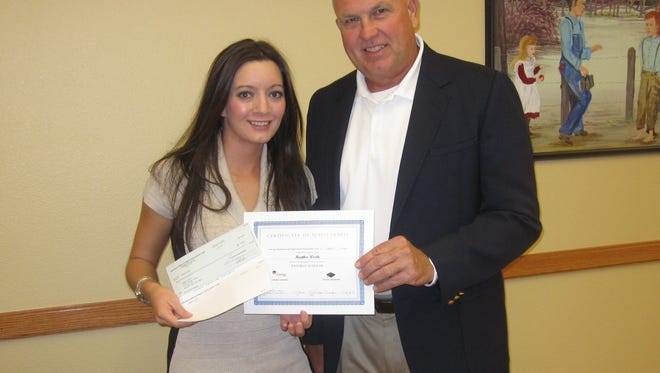 Baxter County Single Parent Entergy Scholarship winner for 2015 Heather Worth is shown with Mark Martin Entergy customer service representative.