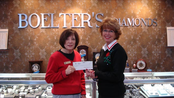 Chris Behnke, from Peters Pantry, recently received a check from Kathy Muench. Boelters Jewelers had pearl earrings that were sold for $5 a pair and all proceeds went to Peters Pantry.