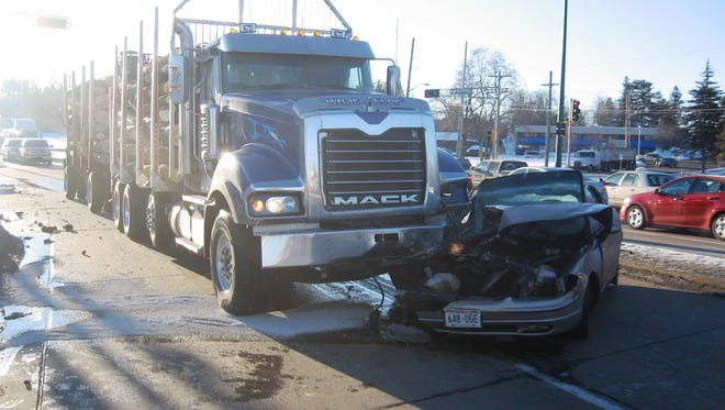 A car turned in front of a semi Wednesday morning on the East Riverview Expressway.