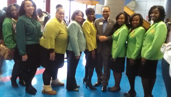 The sisters of Alpha Kappa Alpha Sorority, Gamma Alpha Omega Chapter are pictured with Lane College president Dr. Logan Hampton. The sorority was at Lane College to register people to vote Wednesday.