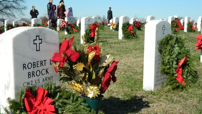 Wreaths are laid at the Kentucky State Veterans Cemetery West near Hopkinsville in 2014.
