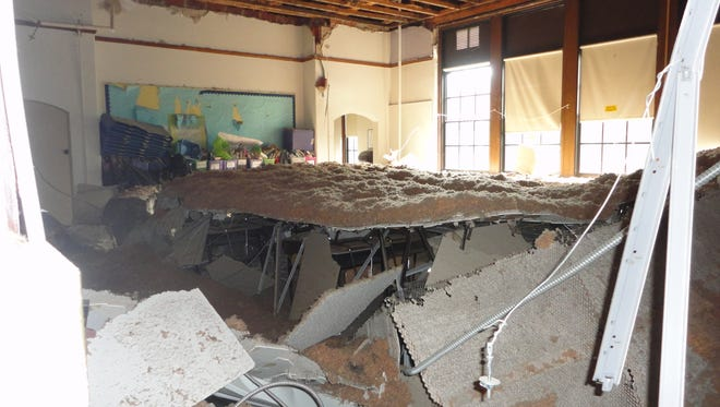 A classroom ceiling collapsed at Daniel Webster Elementary School in New Rochelle last August. Officials said the ceiling had decayed from age and water damage.