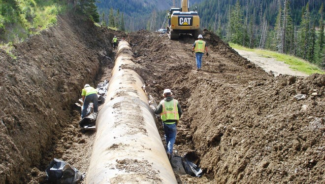 Crews realign a portion of the Michigan Ditch pipeline damaged by a slow-moving landslide in spring/summer 2014. A major project is getting underway to permanently fix the pipeline.