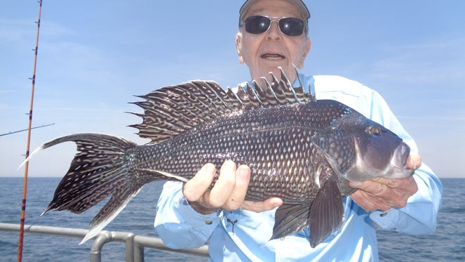 Tom Cahillane of Spring Lake, with a nice sea bass he caught on the party boat Voyager.