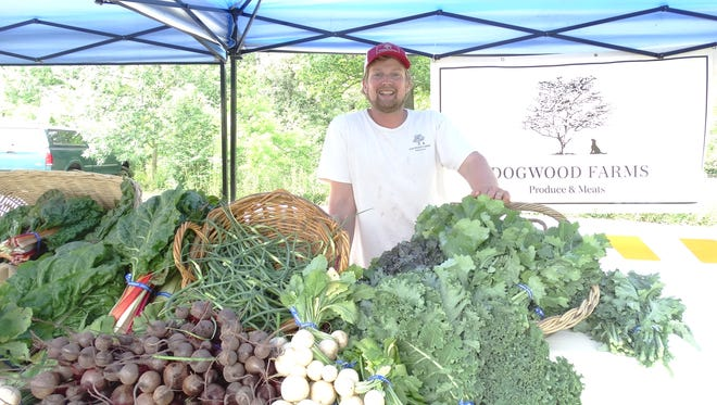 Dogwood Farms owner John Knox welcomes shoppers to try his fresh local produce and meat at Duke Farms' newly-expanded farmer's market.