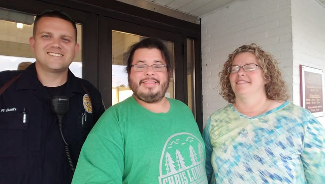 Fremont police officer Pete Bush, Rico Dence, and Lynette Kirsch met by chance Thursday in Fremont when Dence ran out of gas while traveling to Michigan to spread awareness of young adults coping with cancer.