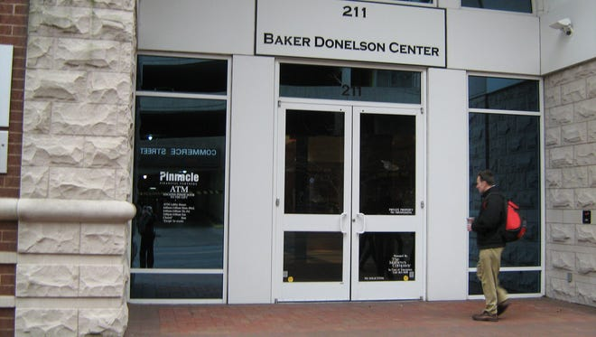 A man enters the Baker Donelson Center at  211 Commerce St. The building houses Nashville offices of the Baker Donelson law firm.