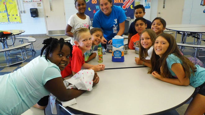 Lely Elementary School campers experiment with science projects at summer camp.