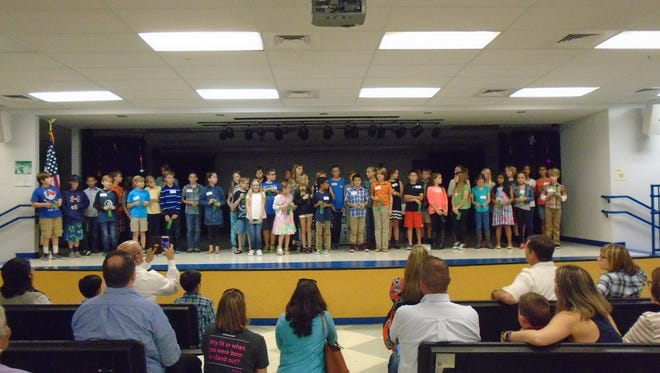 The winners of the Martin County Elementary STEM Fair stand on the stage of the J.D. Parker Elementary School auditorium.