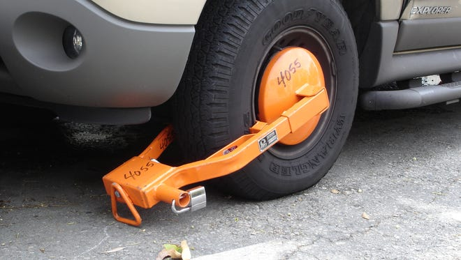 A vehicle boot locks the wheels so that they can't be moved.