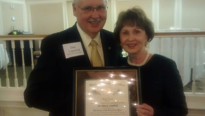 Mars Hill University President Dan Lunsford receives the Order of the Long Leaf Pine from N.C. Independent Colleges and Universities President Hope Williams.