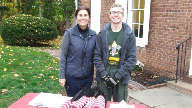 Eleanor Malloy, president of Elmwood Cemetery Association in New Brunswick, with Nicholas James Florczak before graves were marked with medallions and flags for his Eagle Scout project.