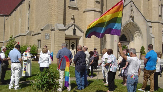 """Last year, after the massacre at the Pulse nightclub in Orlando, members of """"In God's Image"""" gathered at the Church of the Sacred Heart in South Plainfield for a memorial that included plantings and dedicatingplaque on the church grounds."""