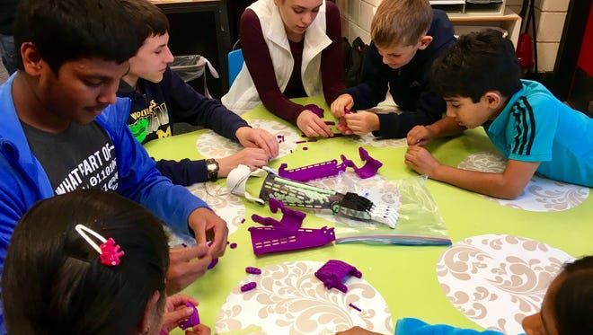 The Novi Public Library is partnering with the Novi High School robotics team to create free 3D-printed limbs for kids overseas who've lost a hand, arm, or fingers due to war, disease, or natural disaster.