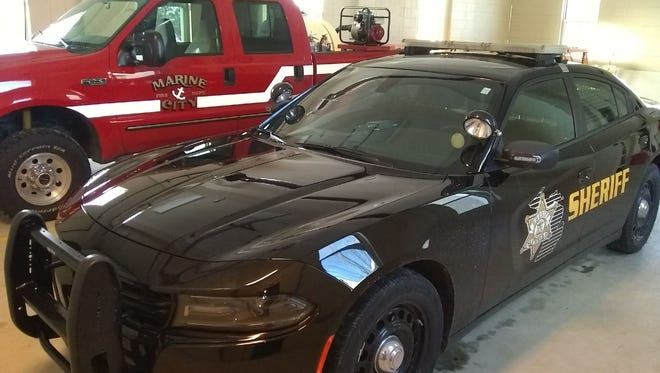A St. Clair County Sheriff's patrol vehicle is shown stored next to a Marine City Area Fire Authority truck in a garage next door to China Township's hall. The township has given both agencies the space to keep vehicles after the structure was renovated.