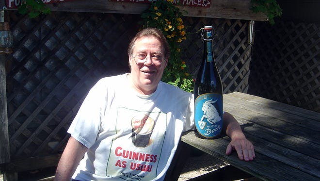 Todd Haefer of Scandanavia, Wisconsin wrote his Beer Man column for 13 years. It was distributed to Gannett newspapers across the country. Here he poses with a 101.4-ounce bottle of Weisser Bock.