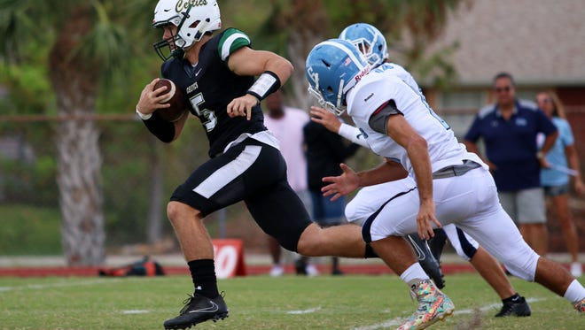 Celtics quarterback Jensen Jones sprints up the field for a 56-yard touchdown during Saturday afternoon's game between Marco Island Academy and St. John Neumann.
