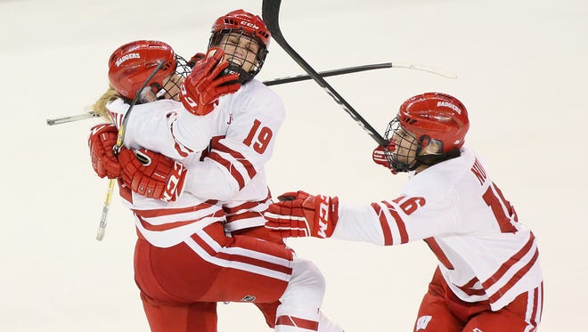 Wisconsin defenseman Mellissa Channell (left) celebrates with teammates Annie Pankowski (center) and Sarah Nurse after scoring the lone goal  against Boston College during an NCAA Frozen Four semifinal/