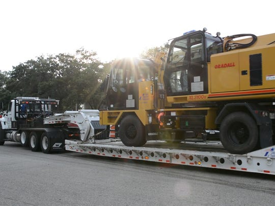 Heavy equipment from Brownwood is loaded up to go the the Texas Department of Transportation staging area in Bryan.