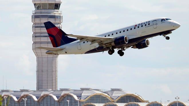 A Delta Air Lines jet takes off from Ronald Reagan Washington National Airport in Arlington, Va.