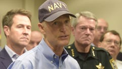 Gov. Rick Scott gives a weather update at the Escambia