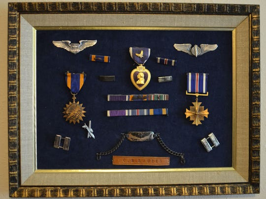 A collection of several, but not all, of Bob Laudie's medals hang on his wall in his Iowa City home.