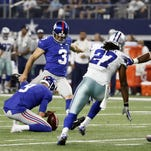 Giants kicker Josh Brown (3) kicks an extra point against the Cowboys on Sunday.