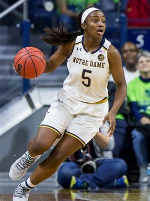 Notre Dame's Jackie Young (5) drives downcourt during the second half of Notre Dame's 71-67 win in an NCAA college basketball game against Green Bay Thursday, Nov. 17, 2016, in South Bend, Ind. (AP Photo/Robert Franklin)