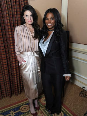 "FILE - This Jan. 13, 2017 file photo shows Idina Menzel, left, and Nia Long posing for a portrait to promote their film ""Beaches"" at the Winter Television Critics Association press tour in Pasadena, Calif. The film, a remake of the 1988 film starring Bette Midler and Barbara Hershey, airs Saturday on Lifetime."