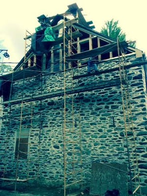 Gable end framing underway on the south wall of the Stone Ridge Library's 1798 building
