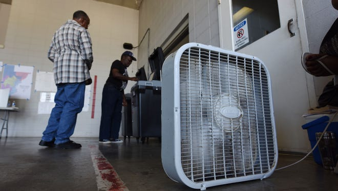 A box fan provides scant relief from the heat at the voting precinct located at Fire Station 26 in Jackson on Tuesday.