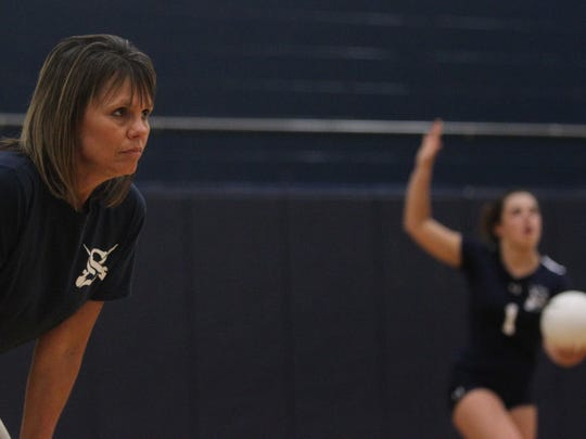 Sneads volleyball coach Sheila Roberts watches her team as daughter Taylor Roberts serves during a senior-night volleyball game last fall. Roberts will be the new volleyball coach at Florida High in fall 2018.
