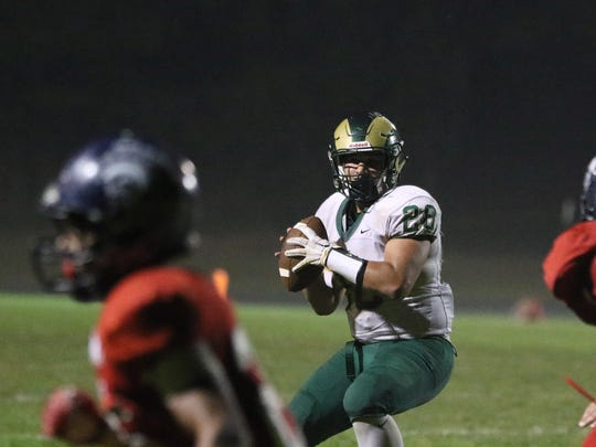Regis's Adair Pelayo and the Rams fall to Kennedy 14-6 in a Tri-River Conference game Thursday, Oct. 8, 2015, in Mount Angel.