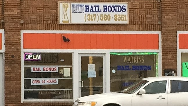 At Kevin Watkins' bail bonds business on Massachusetts Avenue, police found muddy jeans and shoes with blood on them, according to a probable cause affidavit.