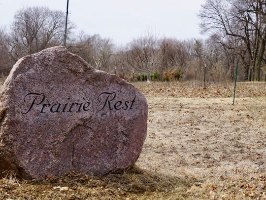 Prairie Rest, the green burial section of Forest Home Cemetery, allows people to be buried in a restored prairie. Their names are etched into granite boulders placed at the edge of the prairie.