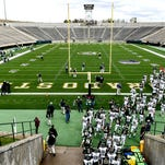 The CSU football team takes the field for the spring football game, Saturday, April 18, 2015, at Hughes Stadium in Fort Collins, CO.