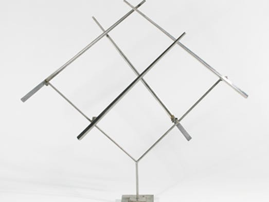 """""""Four Lines Oblique VI"""" by George Rickey was made from stainless steel. Like other pieces in the show, it's from the museum's permanent collection of """"Linear Thinking."""""""