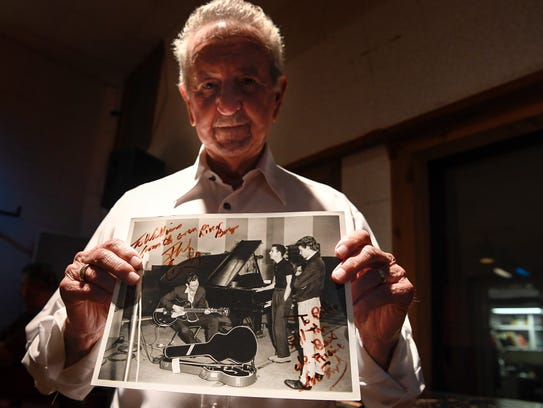Rockabilly artist Billy Harlan holds a picture, Tuesday,