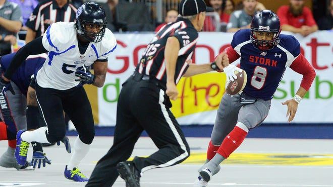 The Storm's Lorenzo Brown carries the ball Saturday night against Cedar Rapids at the Premier Center. The Storm completed an undefeated regular season with a 46-31 victory, their 50th in a row at home in the regular season. The Storm begin the IFL playoffs at home next Saturday, again playing Cedar Rapids.