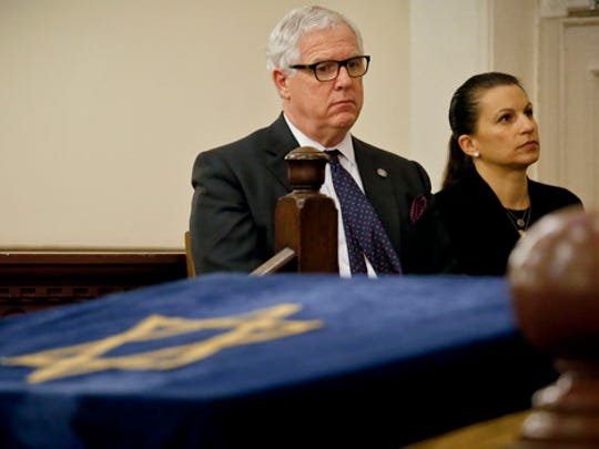Jonathan Miller, left, NYPD deputy commissioner of Intelligence and Counterterrorism, and Karen Friedman Agnifilo, right, New York's chief assistant district attorney, listens during a press conference addressing bomb treats against Jewish organizations and vandalism at Jewish cemeteries, Friday March 3, 2017, at the Park East Synagogue in New York.