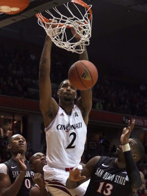 Cincinnati's Octavius Ellis dunks the ball past San Diego State's Skylar Spencer, left, and Winston Shepard on Wednesday.