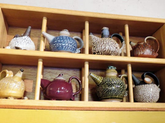 Courtesy Photo   Shown are the miniature teapots crafted by Letha Cress Woolf.  They are shaped in clay, glazed and fired with both skill and love by the Grant County Art Guild's newest member.