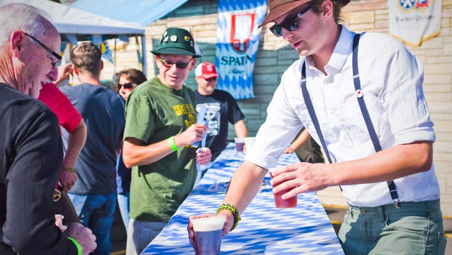 Harry Kispert serves up a couple beers at Oktoberfest at the Lorelei Inn in Allouez in 2016. The 14th annual two-day festival will go on as scheduled on Friday and Saturday.
