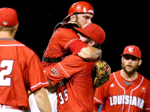 Louisiana-Lafayette's catcher Michael Strentz celebrates with pitcher Matt Plitt (35) after winning an NCAA college baseball tournament regional game against Mississippi State in Lafayette, La., Monday, June 2, 2014.
