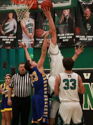 Yellville-Summit's JT Frazier goes up for a layup during the Panthers' victory over Bergman on Tuesday night.