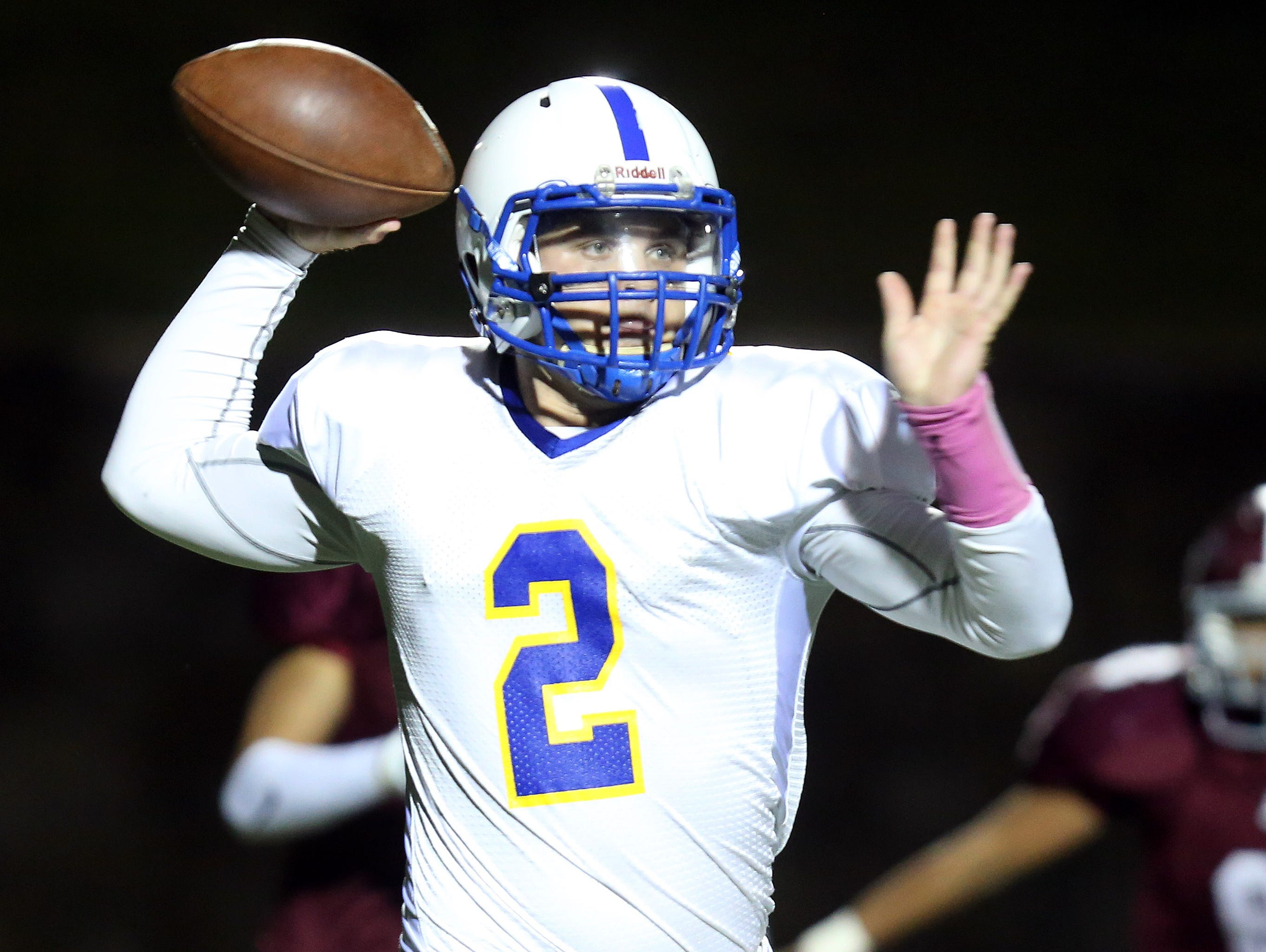 Quarterback Julian McGarvey looks to pass for Ardsley in a 14-7 win against Valhalla Friday night.
