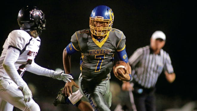 Rickards quarterback DJ Phillips runs the ball during a Region 1-5A semifinal game against West Florida at Gene Cox Stadium on Friday.
