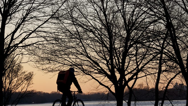 A cyclist rides along Cooper River Park during sunset. The park offers cyclists a loop to ride together or solo.