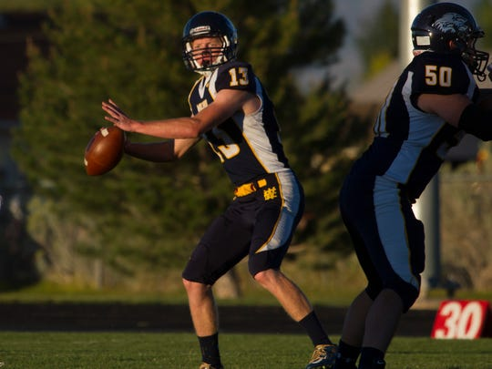 Enterprise High quarterback Jayson Holt throws a pass during a game against Millard earlier this year. Enterprise won 40-7 and is off to the program's first-ever 5-0 start.