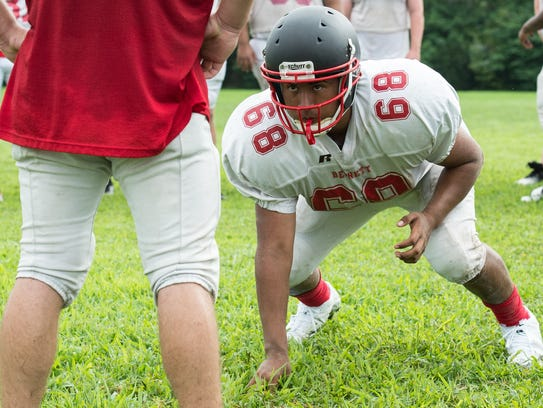 A Bennett football player lines up for a drill during